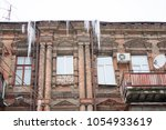 building covered with big... | Shutterstock . vector #1054933619