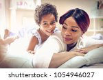 african american mother with... | Shutterstock . vector #1054946027