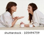 caucasian two women lying on...   Shutterstock . vector #105494759