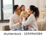 family  parenthood and people...   Shutterstock . vector #1054964384