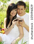 Happy couple with glasses of red wine - stock photo
