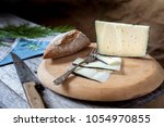 cured cheese on board | Shutterstock . vector #1054970855