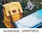 hipster hiker tourist yellow... | Shutterstock . vector #1054970915