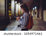 woman with backpack pointing... | Shutterstock . vector #1054971461
