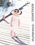 smiling kid girl 3 4 year old... | Shutterstock . vector #1054979339