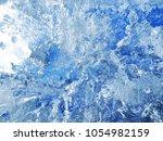 textured ice blue frozen rink... | Shutterstock . vector #1054982159