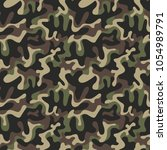 seamless military camouflage... | Shutterstock .eps vector #1054989791
