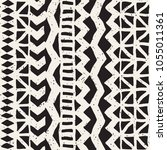 Seamless ethnic and tribal pattern. Hand drawn ornamental stripes. Black and white print for your textiles. Vector geometric background. | Shutterstock vector #1055011361