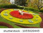 flowerbed clock in english park ... | Shutterstock . vector #1055020445