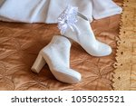 short white boots for bride and ... | Shutterstock . vector #1055025521