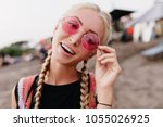 adorable blonde woman posing at ... | Shutterstock . vector #1055026925