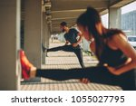 young sports couple exercising... | Shutterstock . vector #1055027795