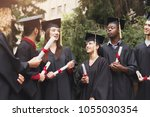 a group of multietnic students... | Shutterstock . vector #1055030354