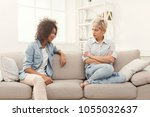 two female friends sitting on... | Shutterstock . vector #1055032637
