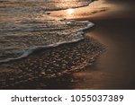soft wave on sandy beach in... | Shutterstock . vector #1055037389