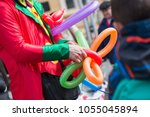 Stock photo a freelance clown creating balloon animals and different shapes at outdoor festival in city centre 1055045894