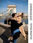 young happy attractive couple... | Shutterstock . vector #1055046065