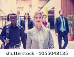 young multi ethnic business... | Shutterstock . vector #1055048135