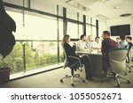 business team meeting in modern ... | Shutterstock . vector #1055052671