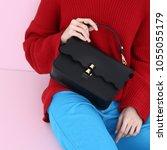 model holds fashion handbag   Shutterstock . vector #1055055179