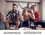 soccer fans emotionally... | Shutterstock . vector #1055056154