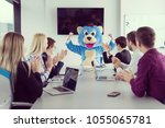 boss dresed as teddy bear... | Shutterstock . vector #1055065781