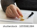 hands of wife  husband signing... | Shutterstock . vector #1055081384