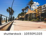 Small photo of Promenade. Promenade on a sunny day. Estepona, Malaga, Spain