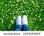 legs in jeans and white sports... | Shutterstock . vector #1055095859
