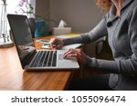 a woman working in an office | Shutterstock . vector #1055096474