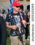 Small photo of PHOENIX, AZ / USA - MARCH 24, 2018: Casey Goble, a pro-Trump and gun rights advocate, sporting his AR-15 slung over his shoulder.