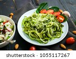 zucchini raw vegan pasta with... | Shutterstock . vector #1055117267