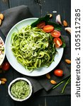 zucchini raw vegan pasta with... | Shutterstock . vector #1055117285