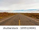 rural desert highway near moab  ... | Shutterstock . vector #1055124041