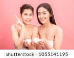 portrait of two beautiful women ... | Shutterstock . vector #1055141195