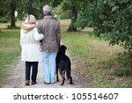 Stock photo older couple walking a dog 105514607