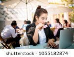 busy young business woman... | Shutterstock . vector #1055182874