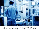 car production line  skilled... | Shutterstock . vector #1055213195