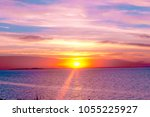 setting into the sea glowing... | Shutterstock . vector #1055225927