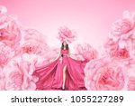 Stock photo fashion portrait of young woman in long red dress with big flowers 1055227289