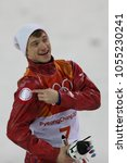 Small photo of PYEONGCHANG, SOUTH KOREA FEBRUARY 18, 2018: Bronze medalist Ilia Burov of Olympic Athlete from Russia during venue ceremony in the Men's Aerials Freestyle Skiing at the 2018 Winter Olympics