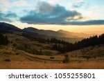 colorful autumn sunset in... | Shutterstock . vector #1055255801