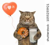 The Cat In Holds A Glass Of...