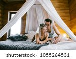 Stock photo lovely couple together at home pretty woman and attractive man wearing home clothes clothes 1055264531