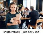 little girl is hugging teddy... | Shutterstock . vector #1055292155