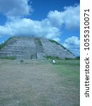 Small photo of IZAMAL, YUCATAN - APRIL 29 2017: a group of mexican tourists. walking in front of the Kinich Kak Moo pyramid . Photographed in Izamal, in Yucatan on April 29 2017