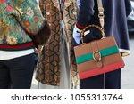 milan   february 21  women with ...   Shutterstock . vector #1055313764