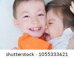 happy kids  laughing children... | Shutterstock . vector #1055333621