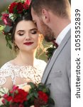 portrait of the bride and groom ... | Shutterstock . vector #1055352839