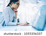 concentrated woman employee in...   Shutterstock . vector #1055356337